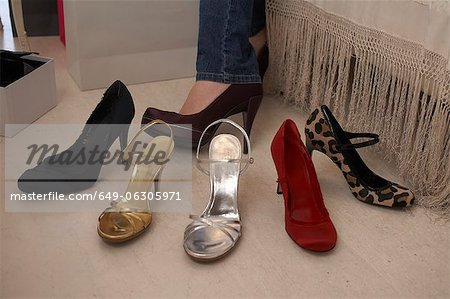 Woman trying on shoes in store Stock Photo - Premium Royalty-Free, Image code: 649-06305971