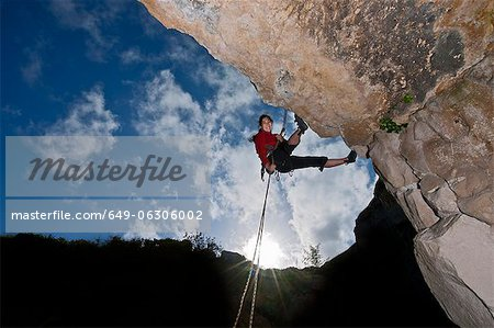 Climber scaling rock face Stock Photo - Premium Royalty-Free, Image code: 649-06306002