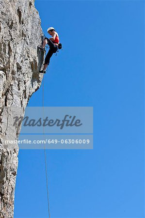 Climber scaling steep cliff face Stock Photo - Premium Royalty-Free, Image code: 649-06306009