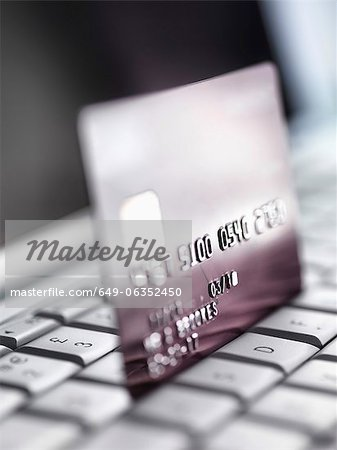 Close up of credit card on keyboard Stock Photo - Premium Royalty-Free, Image code: 649-06352450