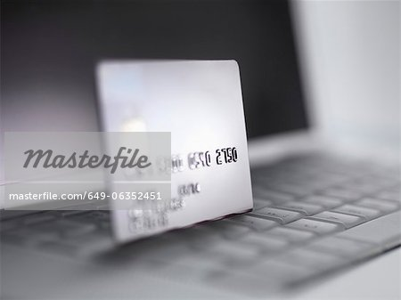 Close up of credit card on keyboard Stock Photo - Premium Royalty-Free, Image code: 649-06352451