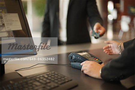 Businessman checking into hotel Stock Photo - Premium Royalty-Free, Image code: 649-06352482