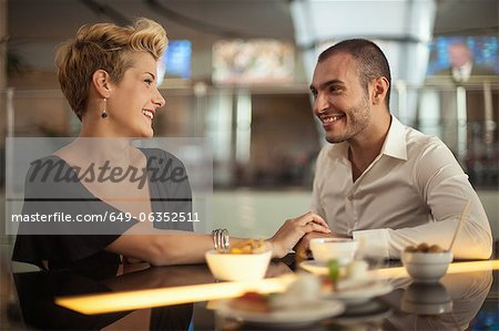 Smiling couple relaxing at bar Stock Photo - Premium Royalty-Free, Image code: 649-06352511