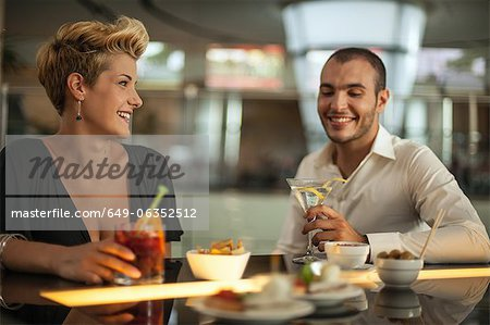 Couple having drinks at bar Stock Photo - Premium Royalty-Free, Image code: 649-06352512