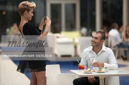 Woman taking picture of boyfriend Stock Photo - Premium Royalty-Free, Image code: 649-06352519