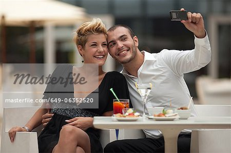 Couple taking picture of themselves Stock Photo - Premium Royalty-Free, Image code: 649-06352520