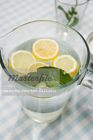Close up of pitcher of lemon water Stock Photo - Premium Royalty-Free, Image code: 649-06352612