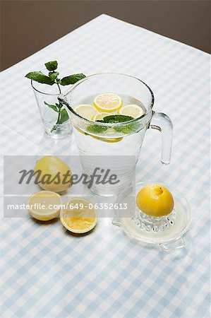 Lemons, herbs and pitcher of water Stock Photo - Premium Royalty-Free, Image code: 649-06352613