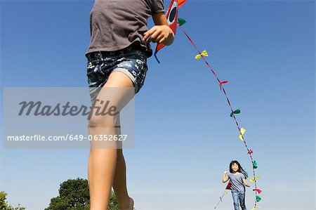 Children playing with kites outdoors Stock Photo - Premium Royalty-Free, Image code: 649-06352627