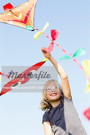 Girl playing with kite outdoors Stock Photo - Premium Royalty-Free, Image code: 649-06352628