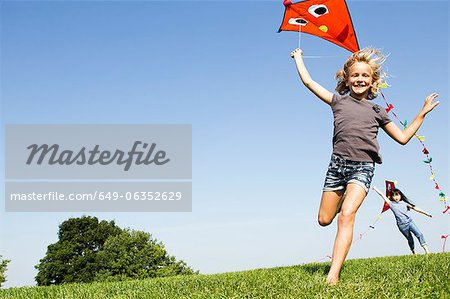 Girls playing with kites outdoors Stock Photo - Premium Royalty-Free, Image code: 649-06352629