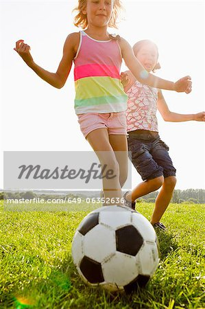 Girls playing soccer in field Stock Photo - Premium Royalty-Free, Image code: 649-06352636