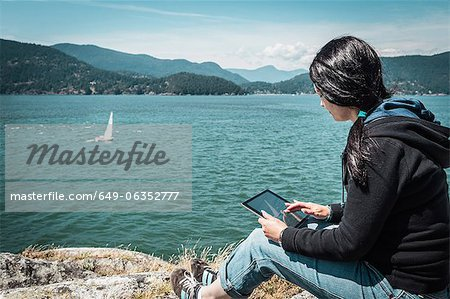 Woman using tablet computer outdoors Stock Photo - Premium Royalty-Free, Image code: 649-06352777