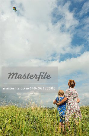 Mother and daughter flying kite in field Stock Photo - Premium Royalty-Free, Image code: 649-06353006