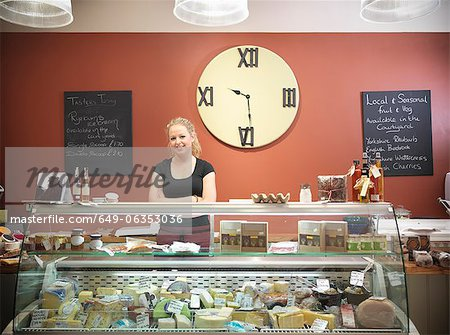 Grocer standing behind counter in shop Stock Photo - Premium Royalty-Free, Image code: 649-06353036