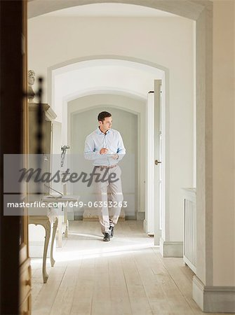 Businessman having coffee in home Stock Photo - Premium Royalty-Free, Image code: 649-06353263