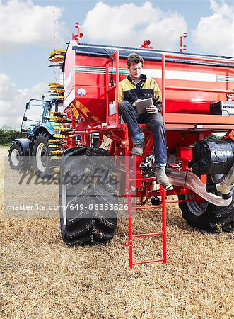 Farmer using tablet computer outdoors Stock Photo - Premium Royalty-Free, Image code: 649-06353326
