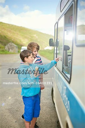 Boys buying ice cream from truck Stock Photo - Premium Royalty-Free, Image code: 649-06400391