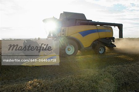 Harvester working in crop field Stock Photo - Premium Royalty-Free, Image code: 649-06400718