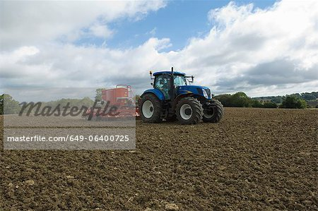 Tractor working in crop field Stock Photo - Premium Royalty-Free, Image code: 649-06400725