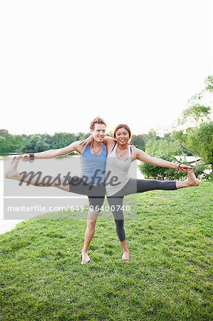 Couple practicing yoga by water Stock Photo - Premium Royalty-Free, Image code: 649-06400740
