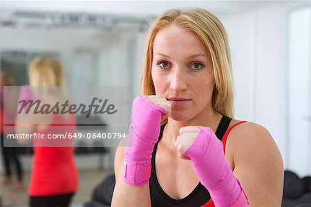 Boxer holding fists up in gym Stock Photo - Premium Royalty-Free, Image code: 649-06400794