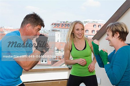 Trainers working with boxers in gym Stock Photo - Premium Royalty-Free, Image code: 649-06400826