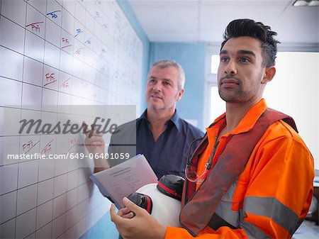 Workers planning operations on board Stock Photo - Premium Royalty-Free, Image code: 649-06401059