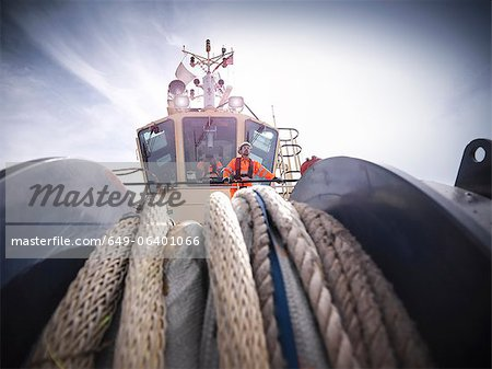 Tugboat worker standing on bridge Stock Photo - Premium Royalty-Free, Image code: 649-06401066