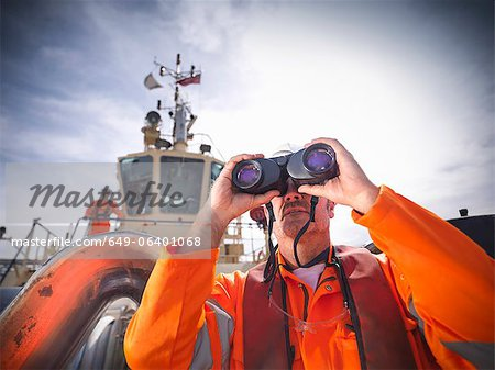 Tugboat worker using binoculars Stock Photo - Premium Royalty-Free, Image code: 649-06401068