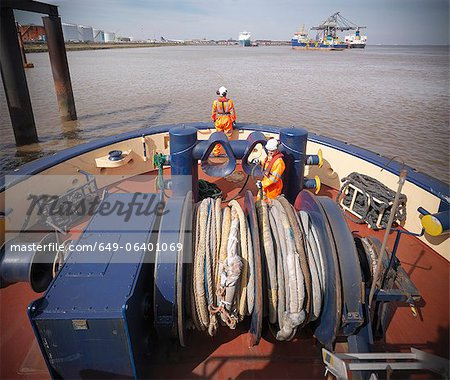 Tugboat worker standing on deck Stock Photo - Premium Royalty-Free, Image code: 649-06401069