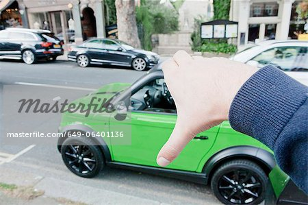Man pretending to hold car Stock Photo - Premium Royalty-Free, Image code: 649-06401136