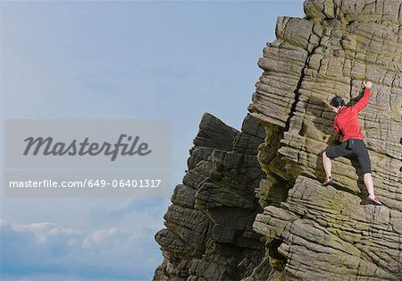 Rock climber scaling rock formation Stock Photo - Premium Royalty-Free, Image code: 649-06401317