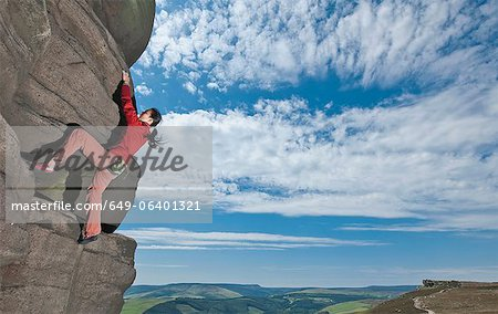 Rock climber scaling rock formation Stock Photo - Premium Royalty-Free, Image code: 649-06401321