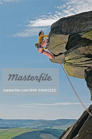 Rock climber scaling rock formation Stock Photo - Premium Royalty-Free, Image code: 649-06401322