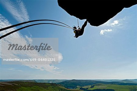 Rock climber scaling rock formation Stock Photo - Premium Royalty-Free, Image code: 649-06401325
