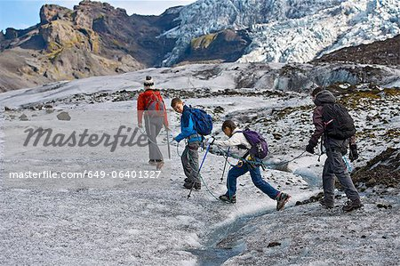 Family walking on glacier Stock Photo - Premium Royalty-Free, Image code: 649-06401327