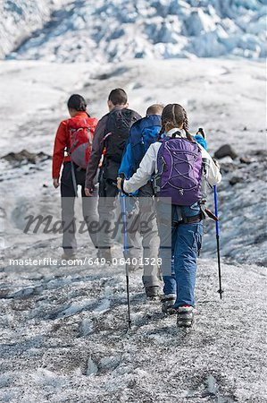 Family walking on glacier Stock Photo - Premium Royalty-Free, Image code: 649-06401328