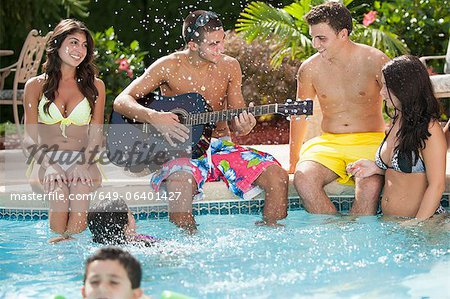 Family relaxing by swimming pool Stock Photo - Premium Royalty-Free, Image code: 649-06401427