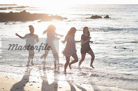 Women running together on beach Stock Photo - Premium Royalty-Free, Image code: 649-06432375