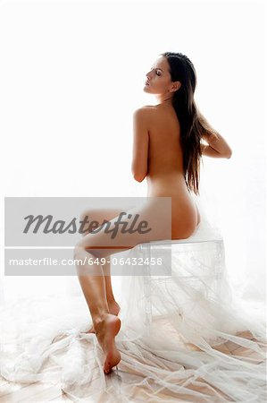 Nude woman sitting on stool Stock Photo - Premium Royalty-Free, Image code: 649-06432458
