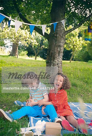 Children yelling at birthday picnic Stock Photo - Premium Royalty-Free, Image code: 649-06432516
