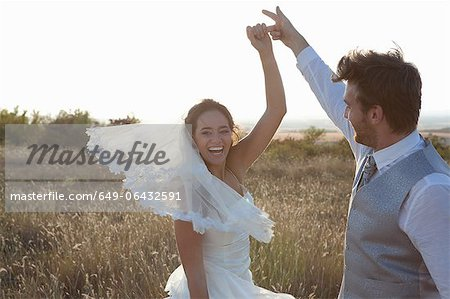 Newlywed couple dancing outdoors Stock Photo - Premium Royalty-Free, Image code: 649-06432591