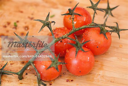 Cherry tomatoes on vine with spices Stock Photo - Premium Royalty-Free, Image code: 649-06432646