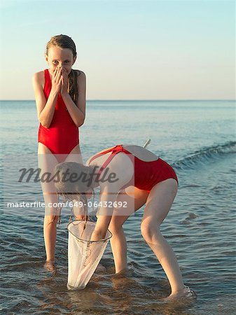 Girls fishing in shallow water Stock Photo - Premium Royalty-Free, Image code: 649-06432692