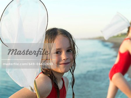 Girls fishing in shallow water Stock Photo - Premium Royalty-Free, Image code: 649-06432693