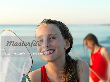 Girls fishing in shallow water Stock Photo - Premium Royalty-Free, Image code: 649-06432694