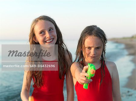 Girls playing on beach together Stock Photo - Premium Royalty-Free, Image code: 649-06432696