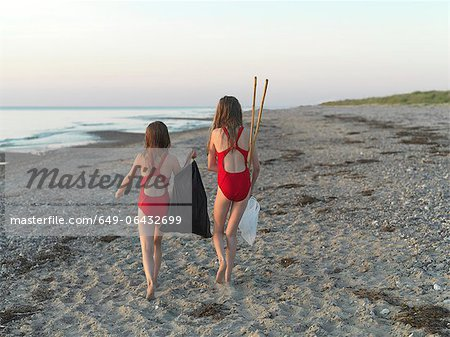 Girls walking on sandy beach Stock Photo - Premium Royalty-Free, Image code: 649-06432699