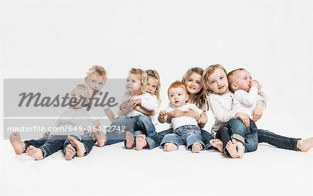 Smiling children posing together Stock Photo - Premium Royalty-Free, Image code: 649-06432742